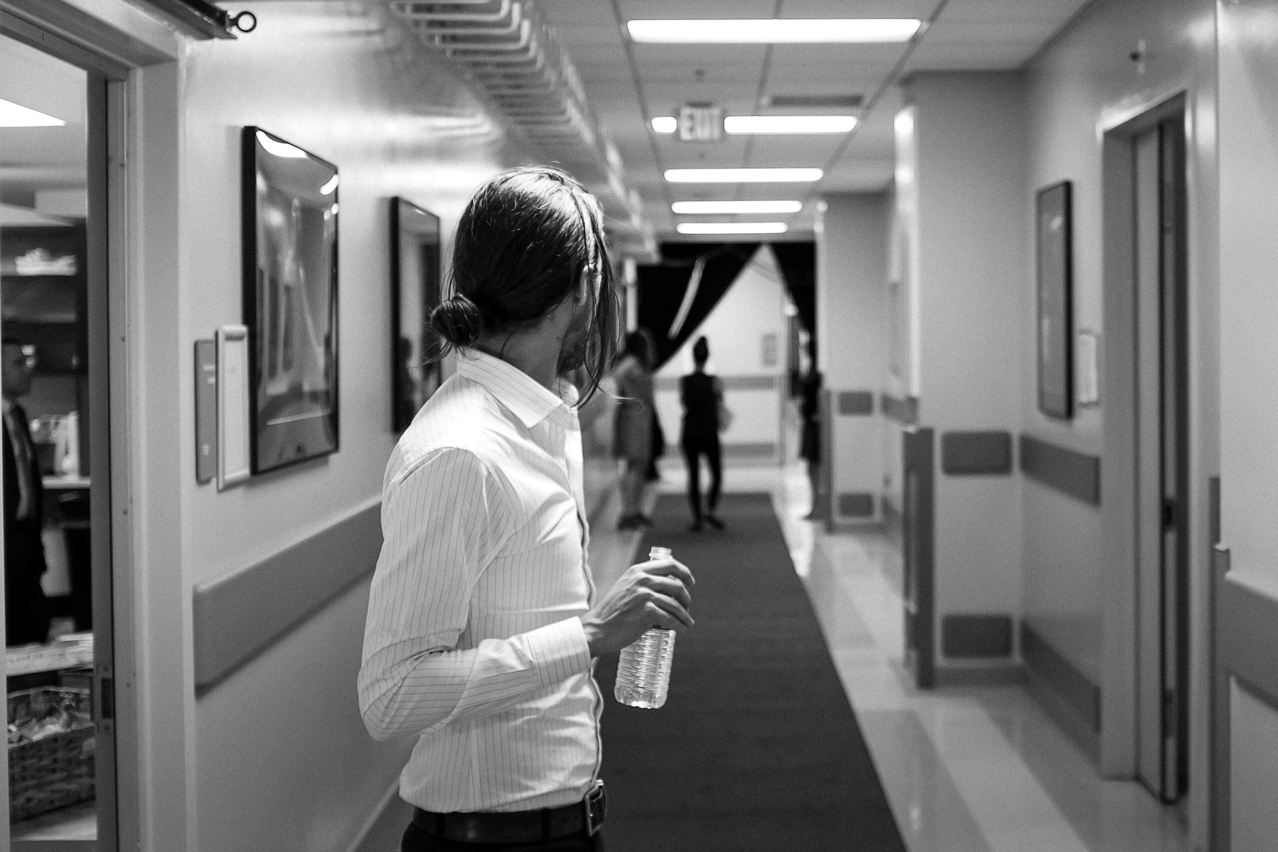 grayscale photography of person wearing white dress shirt