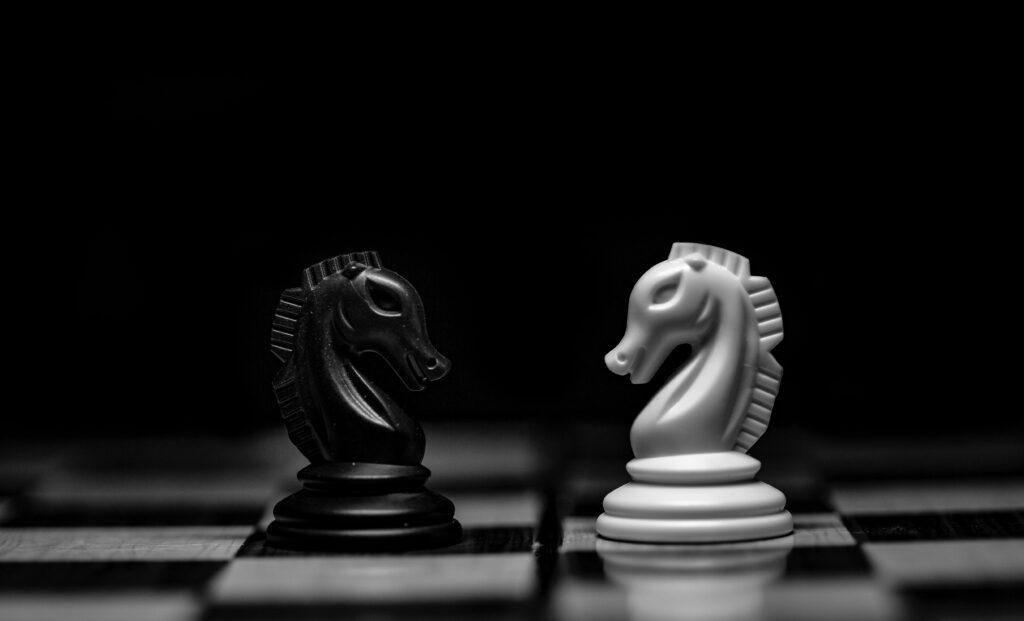 white ceramic figurine on black table
