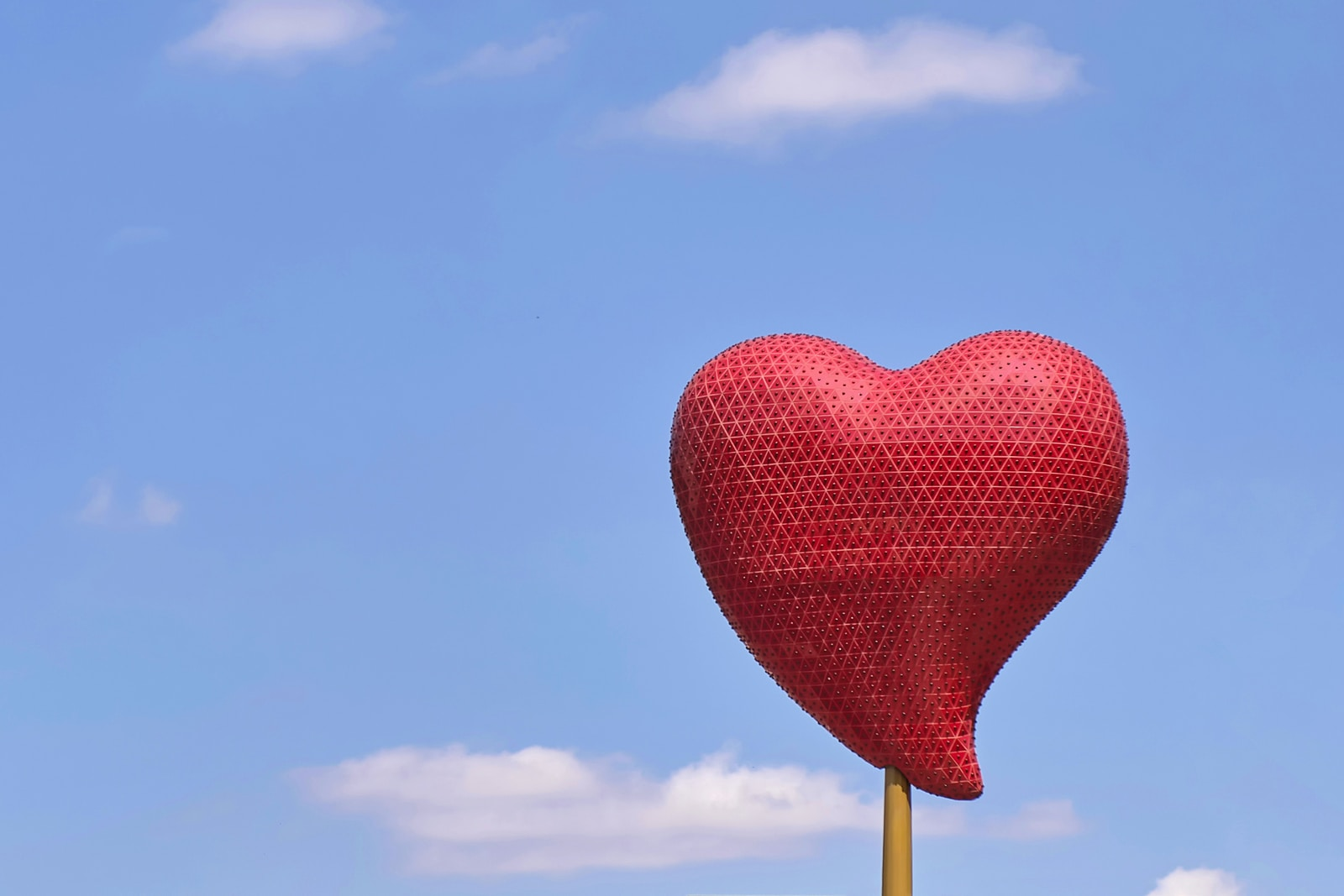 red heart balloon under blue sky during daytime