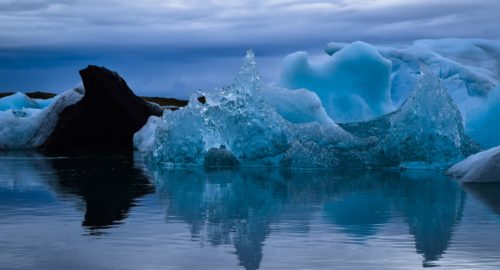 photo of icebergs during daytime