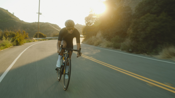 man in black t-shirt riding bicycle on road during daytime