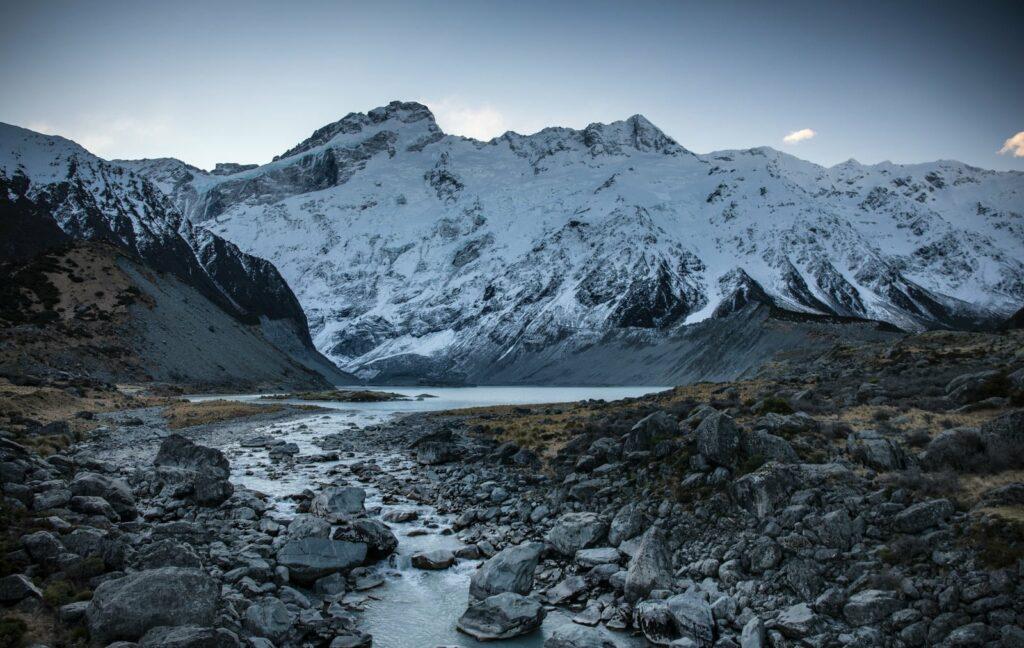 creek under glacier mountain and sky